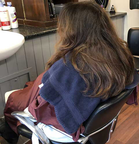 Sharon, a client getting their hair styled in Hair by Julie, the longest established hairdressers in Dufftown, Moray
